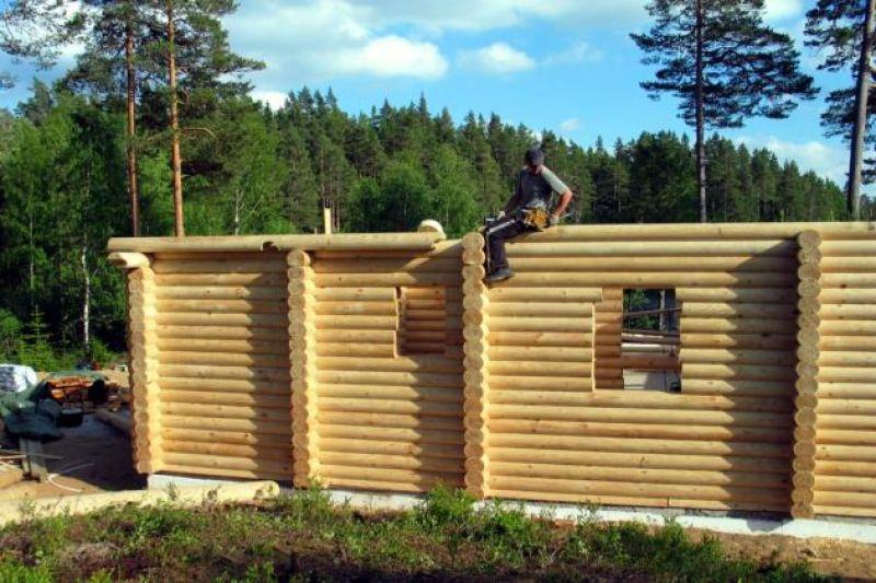 Case in legno in tronchi rotondi, in legno massiccio