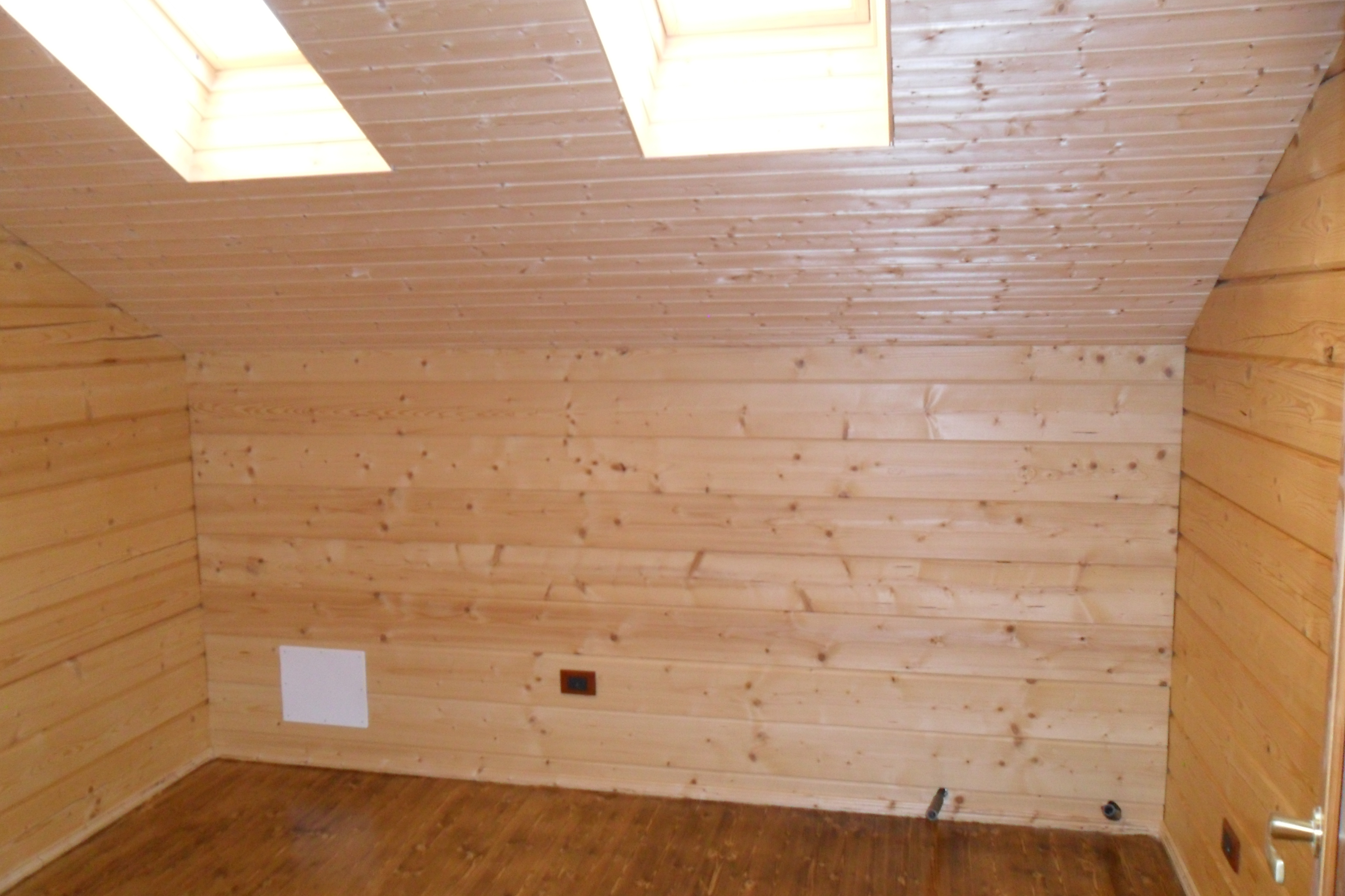 Case in legno in tronchi